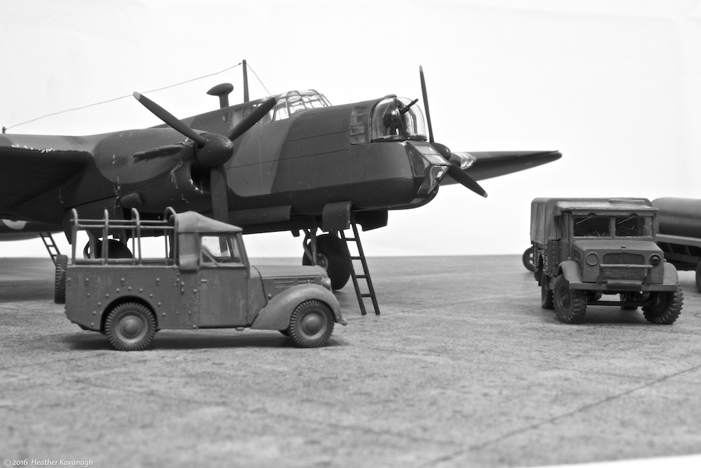 Armstrong Whitworth Whitley MkV, GE-B of No 58 Squadron Bomber Command, Linton-on-Ouse, North Yorkshire, gets some last minute attention before being bombed up for a night raid. Summer 1940. Airfix 1/72nd scale kits for the aircraft, oil bowser and Standard Tilly and Bedford ML pickups; Flightpath Fordson tractor.